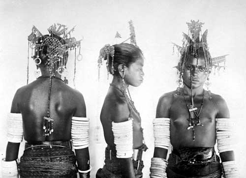 Tanimbar women with their fine headpieces and earrings.